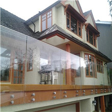 Outdoor side mounted glass balustrade with stainless steel standoff glass railing